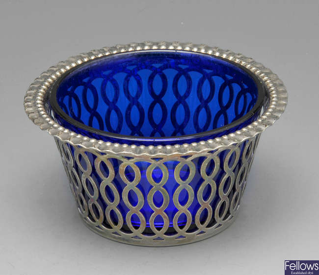 An Edwardian silver sugar dish with blue glass liner.
