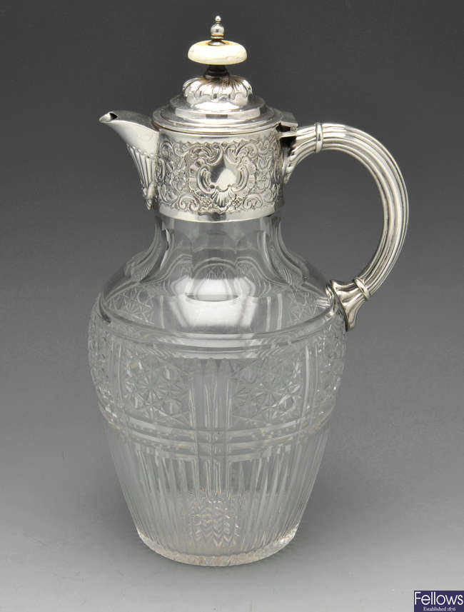 A late Victorian silver mounted claret jug.