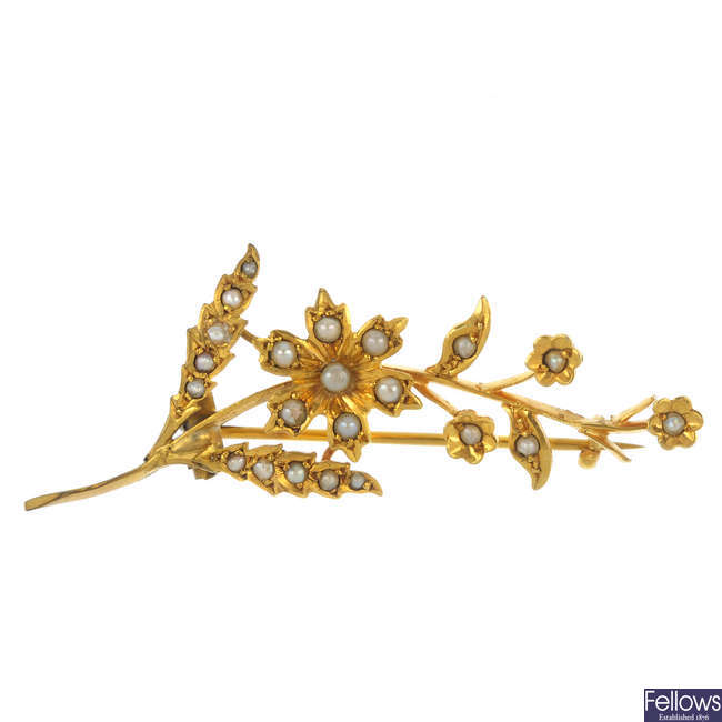 An early 20th century 9ct gold split pearl brooch.