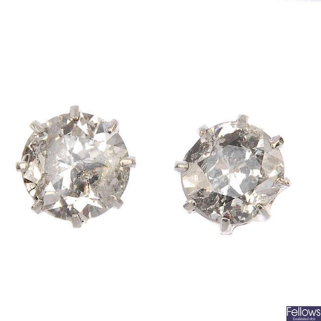 A pair of old-cut diamond single-stone ear studs.