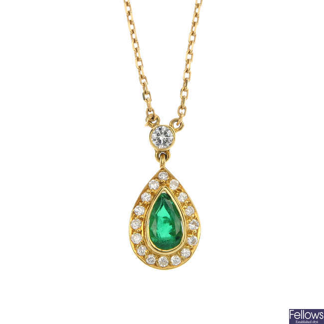 An 18ct gold emerald and diamond cluster pendant.
