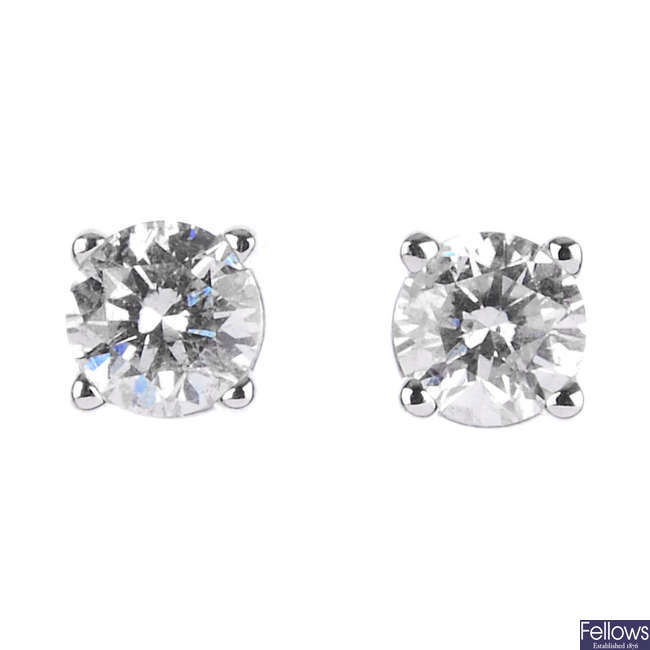 Two pairs of gem-set ear studs.