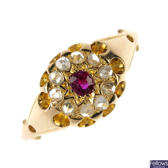 A late Victorian 18ct gold ruby and diamond cluster ring.