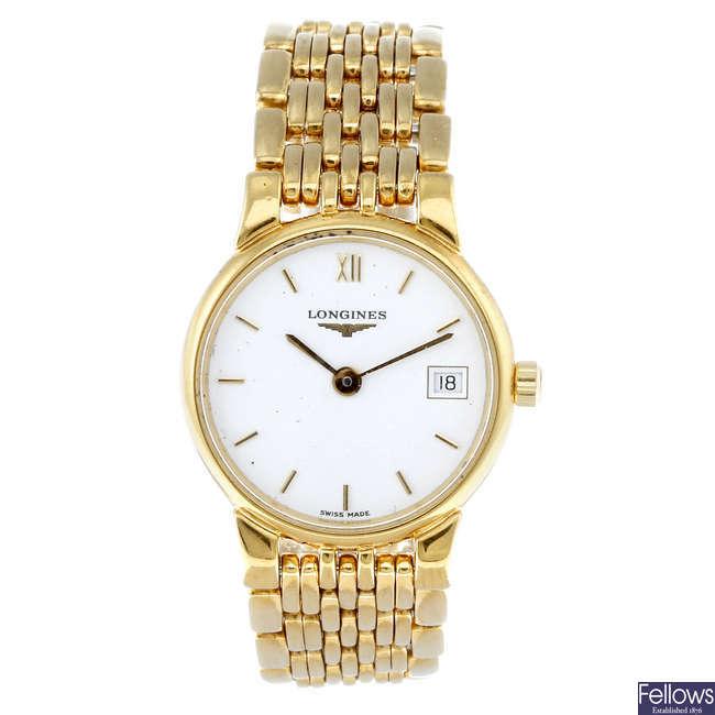 LONGINES - a lady's gold plated La Grande Classique bracelet watch.