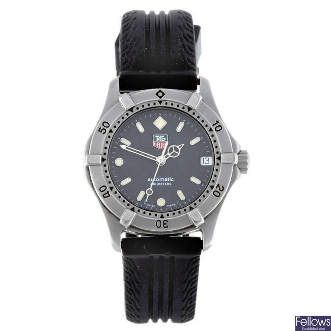 TAG HEUER - a mid-size stainless steel 2000 Series wrist watch.