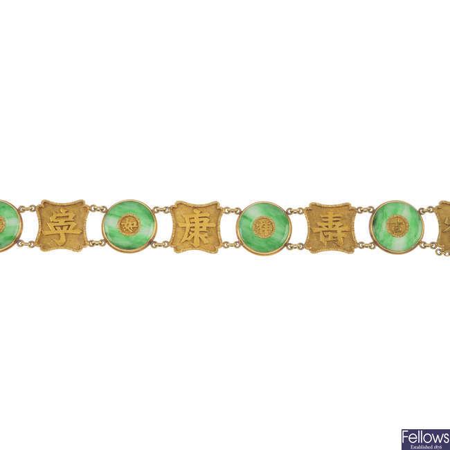 An early 20th century gold jade bracelet.