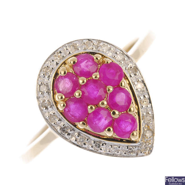 A 9ct gold ruby and diamond cluster ring.
