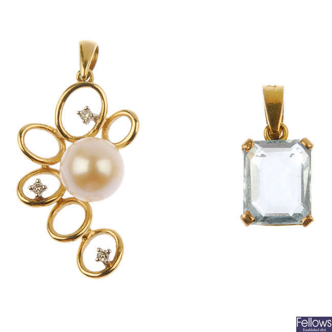 An aquamarine pendant and a cultured pearl and diamond pendant.