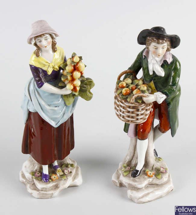 A pair of Capodimonte porcelain figures
