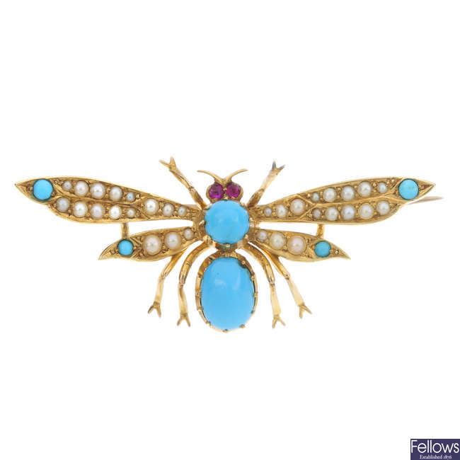 An early 20th century 15ct gold gem-set moth brooch.
