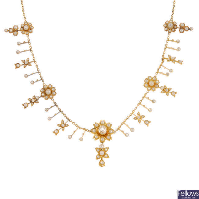 An early 20th century gold diamond and split pearl fringe necklace.