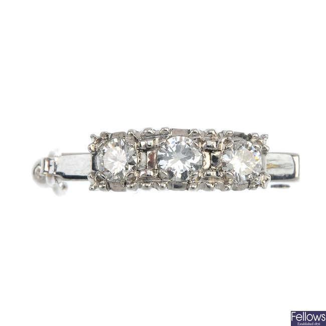 A diamond three-stone pearl enhancer.