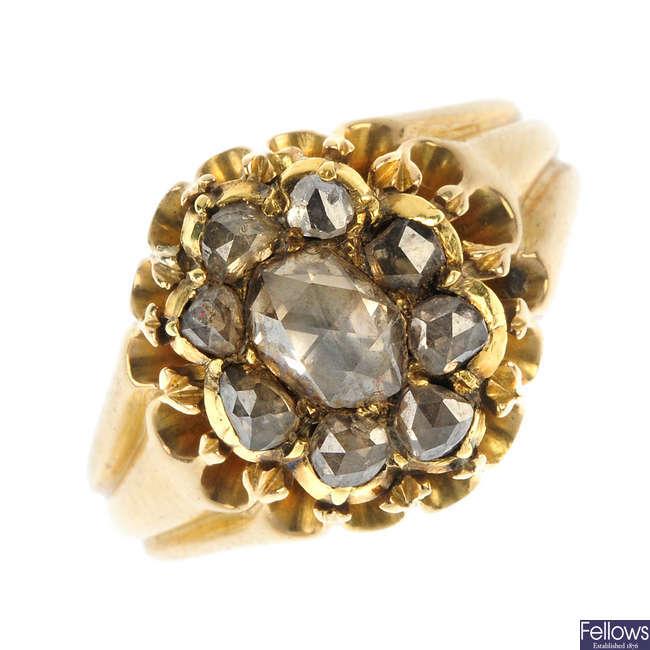A foil-back gold diamond cluster ring.