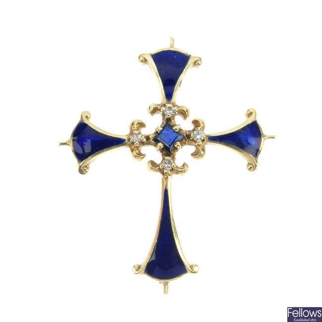 An enamel and gem-set cross pendant.