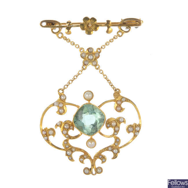 An early 20th century 15ct gold aquamarine and split pearl brooch.
