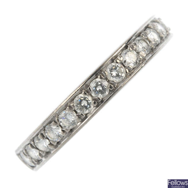 An 18ct gold diamond half-circle eternity ring.
