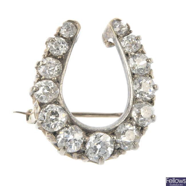 A late 19th century gold diamond horseshoe brooch.