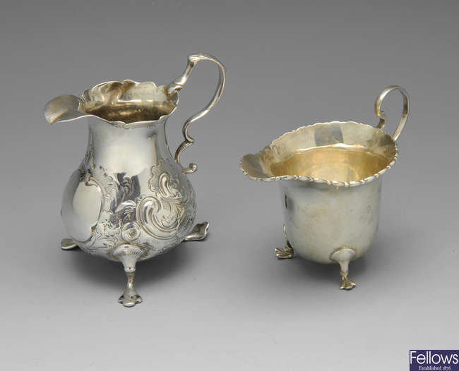 Two silver milk jugs and a silver plated sugar sifter.