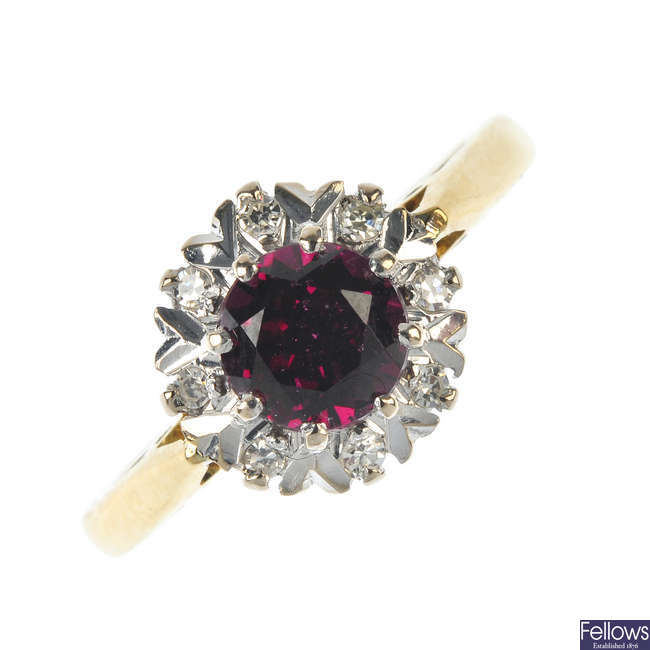 An 18ct gold garnet and diamond cluster ring.