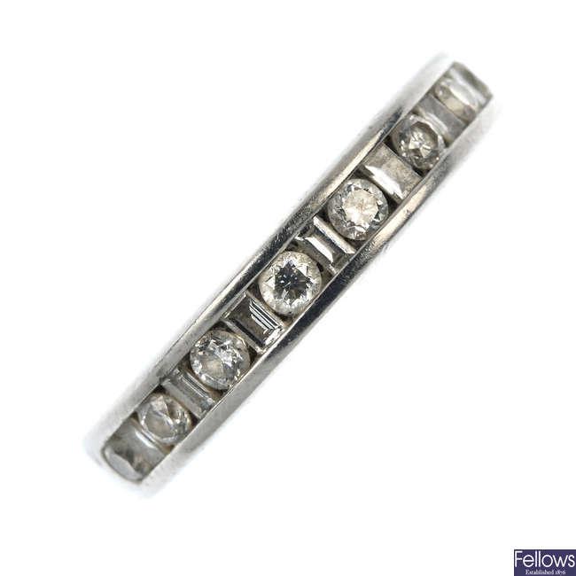 A platinum diamond half-circle eternity ring.