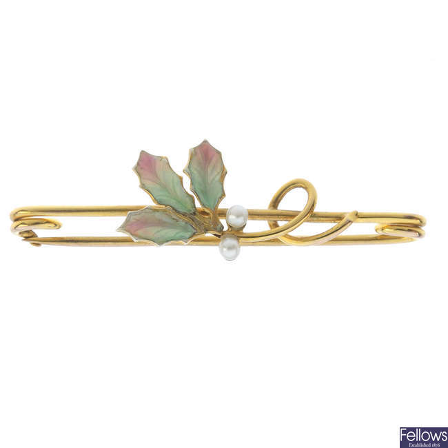 An early 20th century 9ct gold seed pearl and enamel foliate bar brooch.