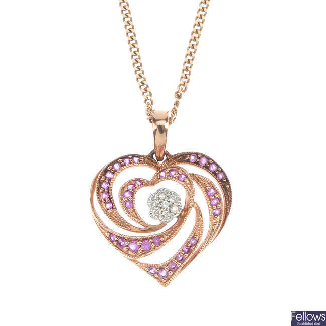 A ruby and diamond heart-shape pendant.