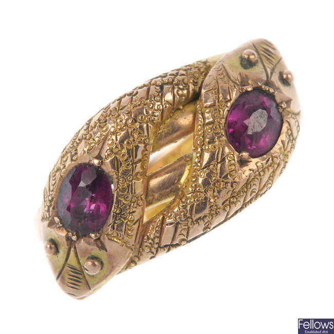 An early 20th century 9ct gold garnet snake ring.