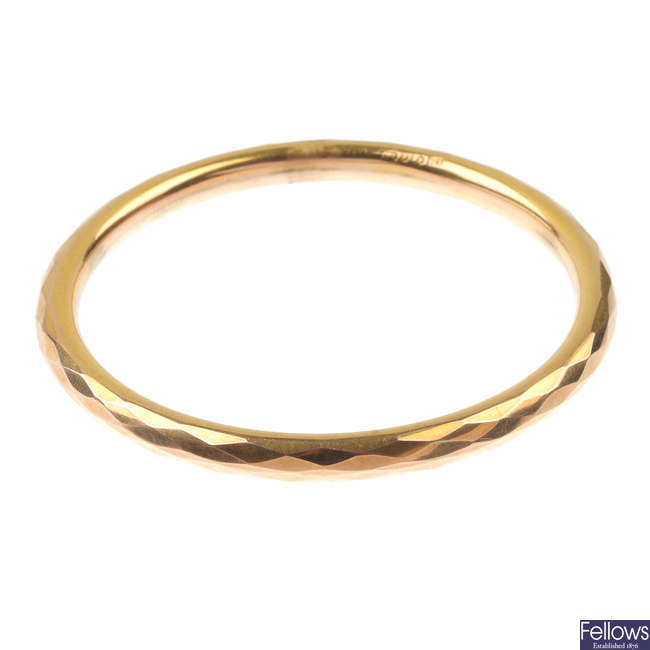 An early 20th century 9ct gold faceted slave bangle.