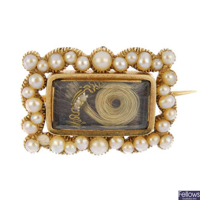 A mid 19th century 12ct gold split pearl memorial brooch.