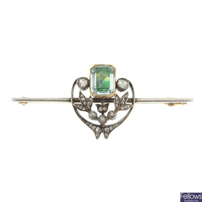 An early 20th century beryl and diamond bar brooch.