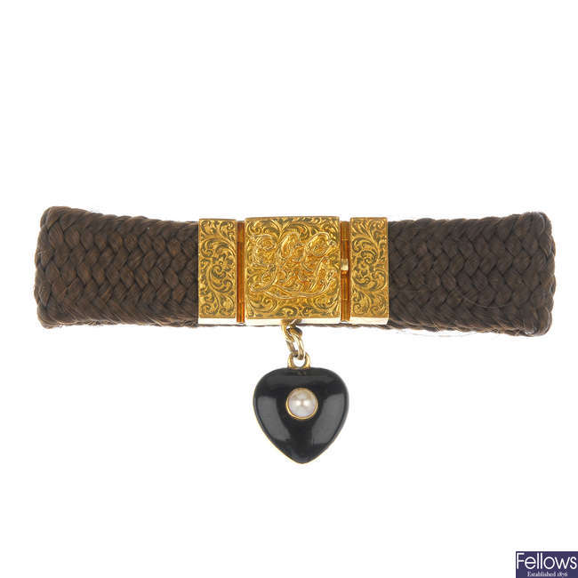 A mid 19th century gold split pearl memorial hair bracelet.