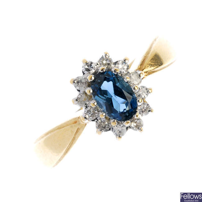 A 9ct gold topaz and diamond cluster ring.