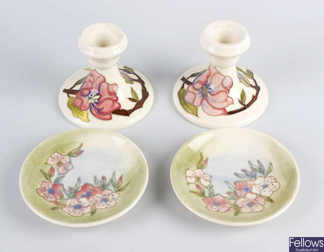 A pair of Moorcroft candlesticks, plus a pair of dishes.