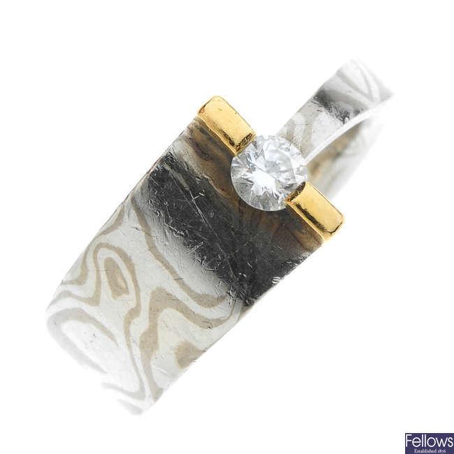 A diamond single-stone Mokume-Gane ring.