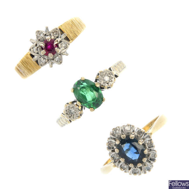 A selection of five gem-set rings.