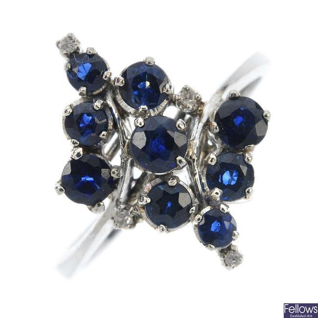 A sapphire and diamond dress ring.