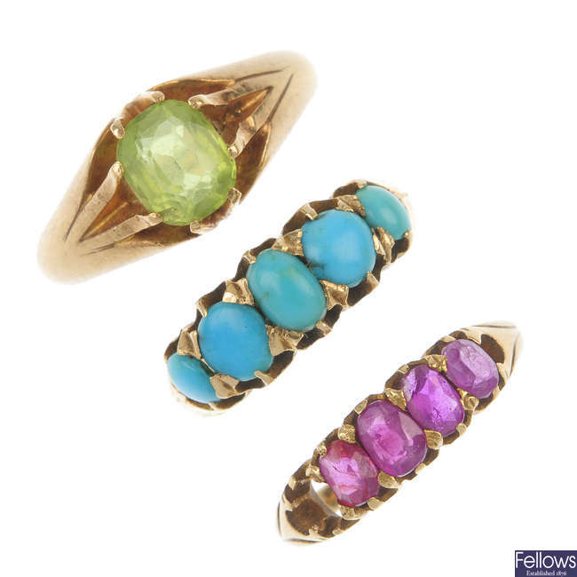 A selection of three gold gem-set rings.