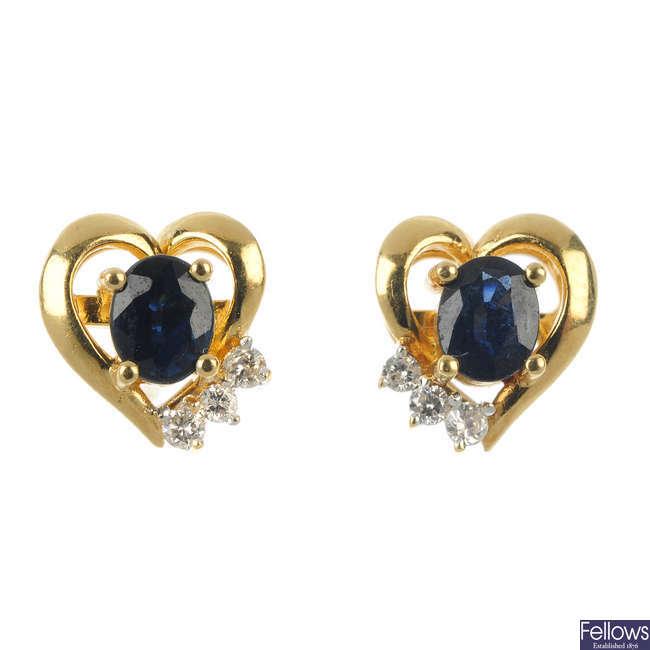 A pair of sapphire and diamond heart ear studs.