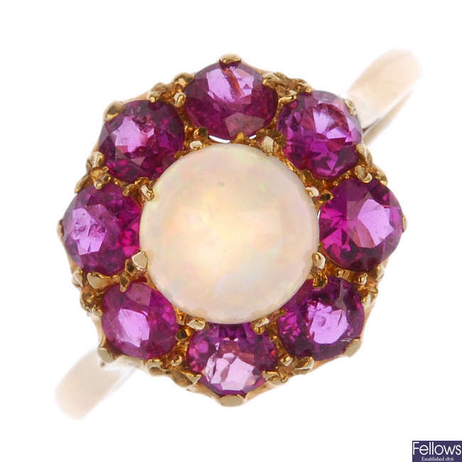 A 9ct gold opal and ruby cluster ring.