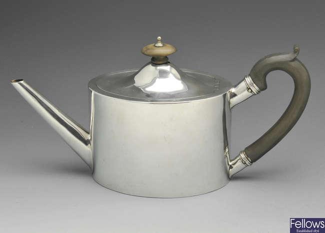A George III small silver teapot.