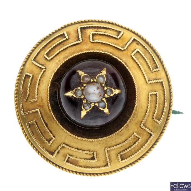 A late 19th century gold garnet and seed pearl brooch.