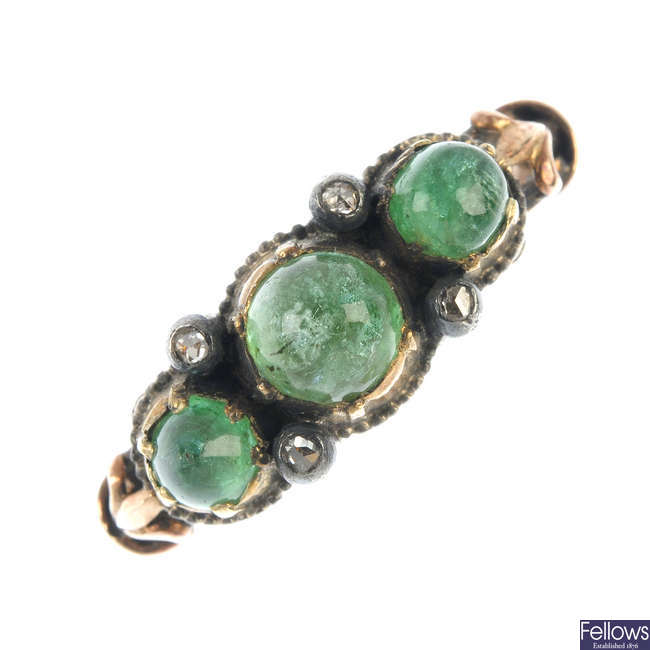 A 9ct gold cabochon emerald and rose cut diamond three stone ring.