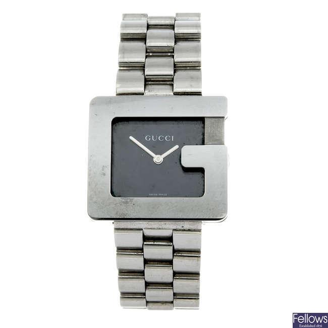 GUCCI - a gentleman's stainless steel G Face bracelet watch.