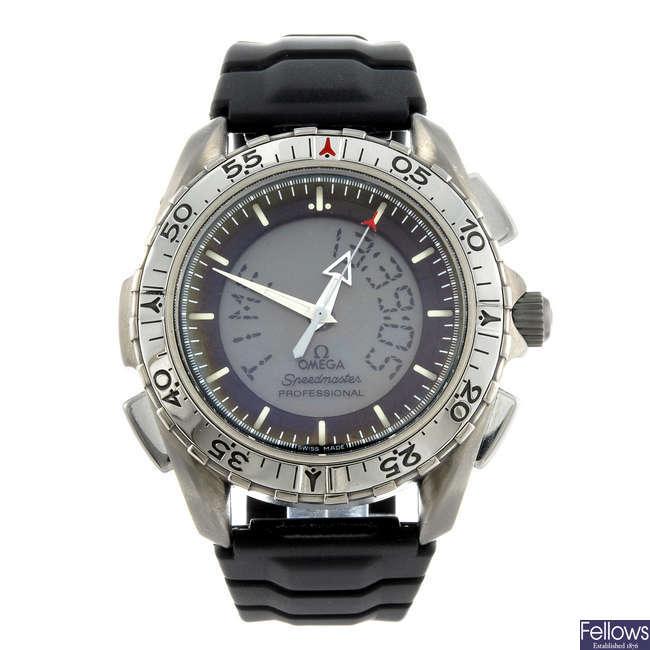 OMEGA - a gentleman's titanium Speedmaster Professional wrist watch.