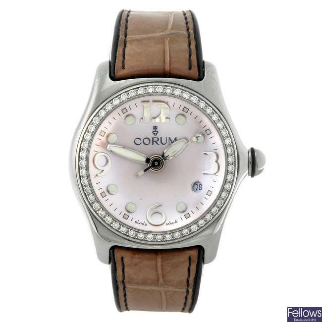 CORUM - a lady's stainless steel Bubble wrist watch.