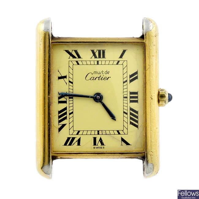 CARTIER - a gold plated silver Must De Cartier watch head.