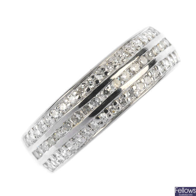 An 18ct gold diamond three-row band ring.