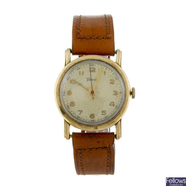 TIMOR - a gentleman's 9ct yellow gold wrist watch.