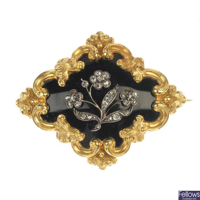 A mid 19th century gold and silver diamond and enamel mourning brooch.