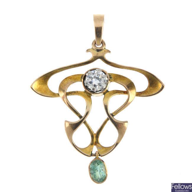 An early 20th century gold gem-set pendant.